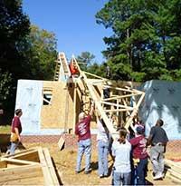 Raising roof on Habitat home